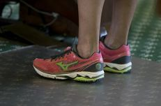 Closeup of State Sen. Wendy Davis' shoes as she begins a filibuster of SB 5 on June 25, 2013.