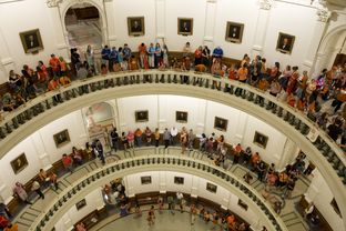 A line of hundreds of protesters snakes through the Texas Capitol rotunda during the Senate filibuster on June 25, 2013.