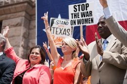 Sen. Leticia Van de Putte, Sen. Wendy Davis, and Sen. Royce West cheer at the Stand with Texas Women Rally at the Capitol.