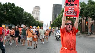 Abortion rights activists march through downtown Austin on July 1, 2013.