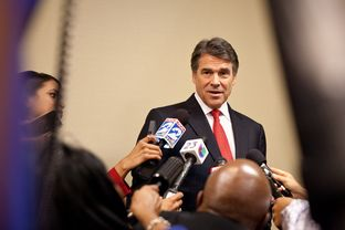 Gov. Rick Perry answers press questions at the National Right to Life convention.