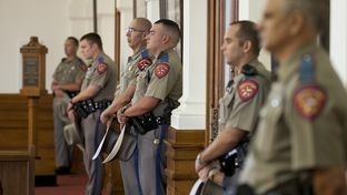 A line of Dept. of Public Safety (DPS) troopers keeps order in the House gallery on July 9, 2013.