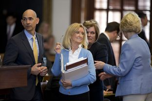 State Rep. Jodie Laubenberg, R-Parker, holds her bill book on HB 2 during long debate on amendment #9 July 9, 2013.