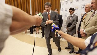 Gov. Rick Perry answers a question on the south Texas university merger following the ceremony at UT-Brownsville on July 16, 2013.