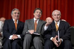 Dr. Francisco Cigarroa, Gov. Rick Perry and UT Board Chairman Gene Powell celebrate the merger at UT-Pan American on July 16, 2013.