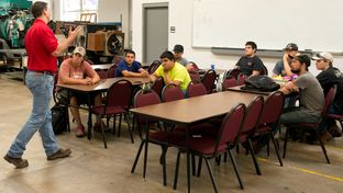 "Keith Plantier lectures in a ""Wind Safety"" course at Texas State Technical College in Sweetwater, Texas, on July, 22, 2013. The college is placing more of an emphasis on courses that will help their students find employment in the growing number of oilfields and wind farms in West Texas."