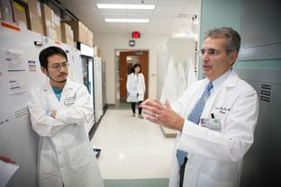 Ronald DePinho, president of The University of Texas MD Anderson Cancer Center, visiting labs on the south campus in Houston Monday Sept 30, 2013.