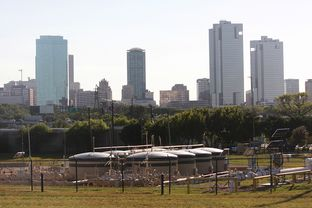 A well pad is flanked by Fort Worth's skyline on Sept. 27, 2013. As the Dallas City Council debated tightened regulations for natural gas drilling that it approved Wednesday, observers pointed to nearby Fort Worth's ordinance as a model to either embrace or avoid.