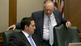 State Rep. Dan Flynn, R-Canton, right, speaking to state Rep. Trey Martinez Fischer, D-San Antonio, on Oct. 23, 2013.