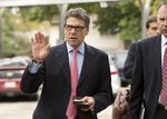 Gov. Rick Perry heads into a west Austin early voting site on Oct. 30, 2013.