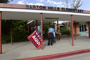 A wind-blown sign directed voters to Barton Hills Elementary, Precinct 342, Austin on Nov. 5, 2013.