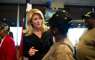 State Senator Wendy Davis speaks with Carnisha Campbell, an Army veteran, at Luby's in Forrest Hill during their Veterans Day Breakfast on November 11, 2013.