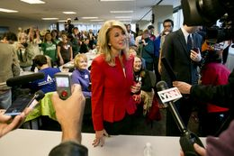 Democratic candidate for Governor of Texas, Sen. Wendy Davis, speaks to press after meeting with volunteers at a phone bank in Austin, Texas