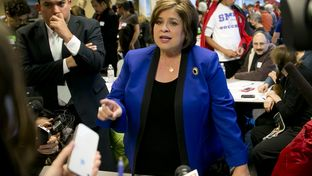 State Sen. Leticia Van de Putte speaking to press during a visit to a phone bank in Austin.