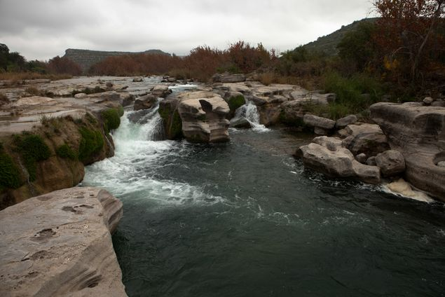 Dolan Falls is directly downstream from the confluence of the Devils River and Dolan Creek.
