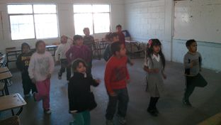 Children who participate in an after school program in Ciudad Juárez dance to Beyoncé as part of their routine. The program is one of several Merida Initiative projects in this border city designed to help the city rebound.