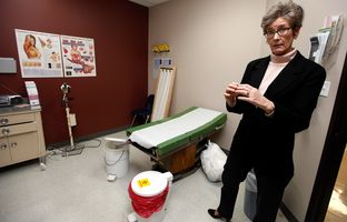 Standing in one of the six exam rooms, Chief Executive Officer Carolena Cogdill explains the services offered at Haven Health Clinics in downtown Amarillo Monday, Dec. 9, 2013. The clinic provides services for women in the 26 county region of the Texas panhandle.