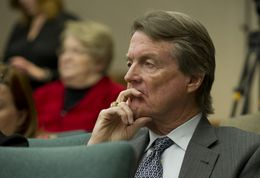 UT President Bill Powers waits at the House Select Committee on Transparency in State Agency Operations on Dec. 18, 2013