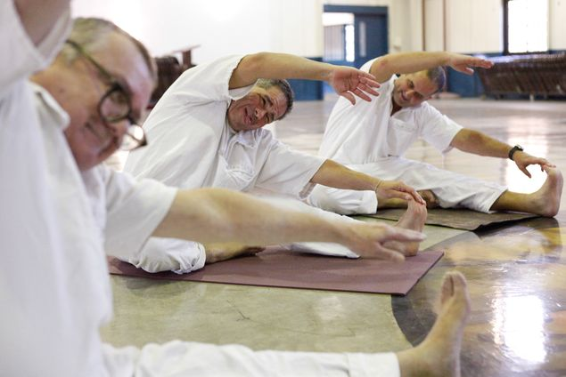 Inmates at the Powledge Unit in Palestine participate in a yoga class on Dec. 10, 2013.