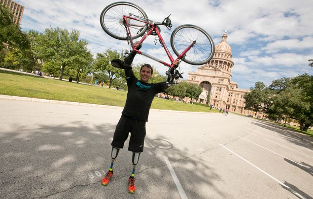 Carlos Gutierrez finishes his 13-day bike ride across Texas in Austin on Nov. 9, 2013.