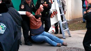 Cristina Parker gets arrested during a protest against the Secure Communities program.