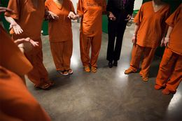 Pregnant and just postpartum inmates join hands in a circle after their life skills session in the pregnancy tank at the Harris County Jail in Houston Tuseday, February 11, 2014. The Mentoring Moms program is a relatively new reentry service at the jail set up to mentor the women and connect them with services on the outside upon their release.