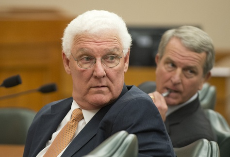 John Specia (left), the commissioner of the Texas Department of Family and Protective Services, and Health and Human Services Executive Commissioner Kyle Janek testify Feb. 20, 2014, at a Senate Health and Human Services Committee hearing.