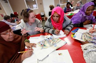 Volunteer Jennifer Butler, second from left, works with Somali immigrants Saharlo Adlle, from left, Zainab Botnb and Ikyan Seer during an English as a second language class at an apartment complex in Amarillo on Feb. 15.