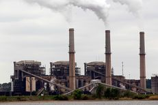 Steam rises from the stacks at the Martin Lake Coal-Fired Power Plant in Tatum, TX
