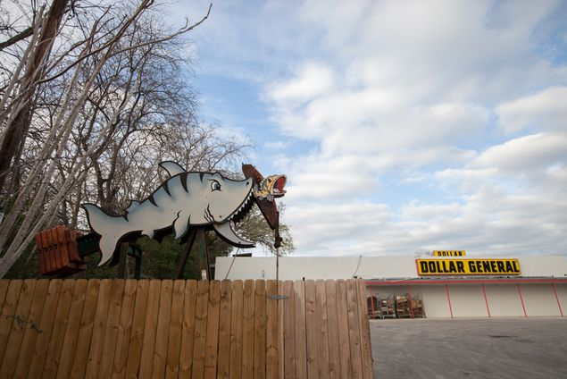 A shark chomps at a fish in the Dollar General parking lot. This is one of several art installations in Luling created by George Kalisek, an artist based in Moulton. Kalisek says the installations with moving parts are toughest to design, but they are his favorite.