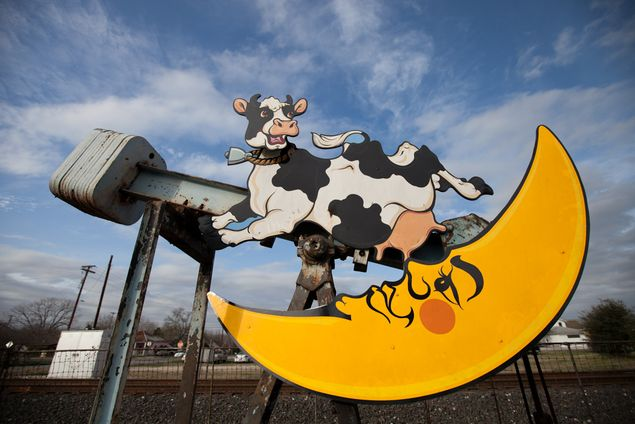 A few feet away from the train tracks that split Luling, a pump jack showcases a cow jumping over the moon.
