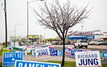 2014 candidate signs outside of the Travis County tax office on Feb. 27, 2014