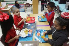 School children at Cantu Elementary in San Juan, Texas, eat their free breakfast, Wednesday April 24, 2013.