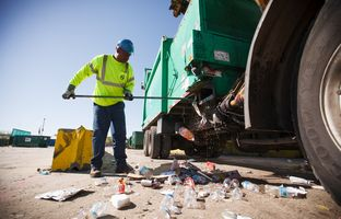 Glenn Bailey cleans out a city of Houston recycling truck on March 18, 2014.