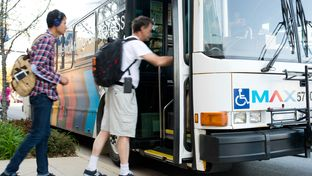 Passengers board the Metro ArlingtonXpress at the University of Texas at Arlington bus stop on March 31, 2014.