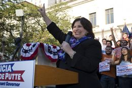 "Lt. Gov. candidate Leticia Van de Putte, D-San Antonio, flashes ""Hook 'em Horns"" at a UT rally April 7, 2014."