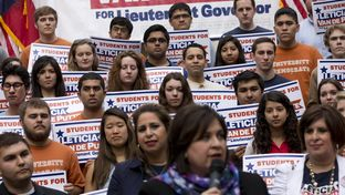 Supporters of Sen. Leticia Van de Putte, D-San Antonio, rally behind her at the University of Texas on April 7, 2014.