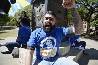 Patrick Fierro and other activists chant during a protest at the University of Texas at Austin on April 9, 2014. They were protesting the Obama administration's record on deportations.