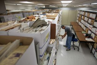 "Daniel Ortuño, who manages the 1.5 million drilling records stored at the University of Texas at Austin's Bureau of Economic Geology, examines well data in what he calls the ""spooky room,"" home to thousands of records that he has not yet organized. State water researchers are using information from some logs to map potential water sources."