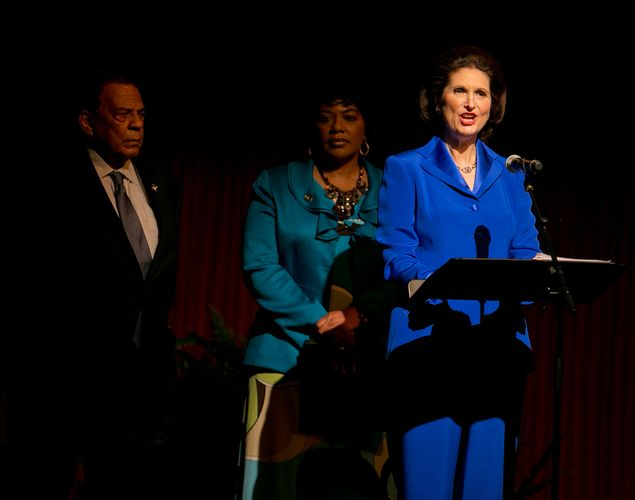 Lynda Johnson Robb, daughter of former President Lyndon Johnson, gives a reading prior to a speech by former President Bill Clinton during the Civil Rights Summit on April 9, 2014. At left is Andrew Young, and center, Bernice A. King, daughter of Martin Luther King. 