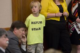 "Waco ISD elementary school student, William Massey, wears a t-shirt that says ""refuse STAAR"" during a senate committee on education hearing on April 14th, 2014"
