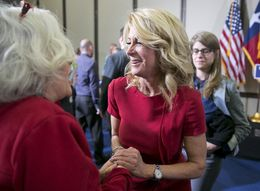 Texas Senator and Gubernatorial candidate, Wendy Davis greets a supporter following an education rally in Austin on April 14th, 2014