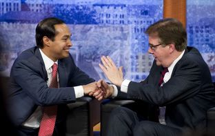 Mayor Julian Castro and Sen. Dan Patrick shake cordially after their San Antonio debate on April 15, 2014.