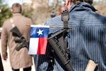 Gun rights supporters participate in an open carry march through South by Southwest  led by the Austin chapter of Come and Take It on Wednesday, March 12.