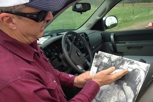 Tommy Henderson shows a survey of land along the Red River in North Texas. Three decades ago, an Oklahoma judge said 140 acres of land he managed belonged to the federal government – even though Henderson held the deed and diligently paid his taxes. Now, the federal government is weighing what to do with more land along the river, some of which has been in North Texas families for generations.
