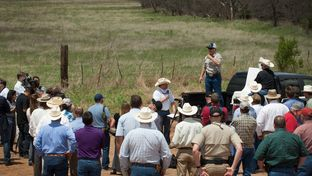 Texas landowner Tommy Henderson speaks to a gathering of politicians, landowners, law enforcement and media at the bridge over the Red River on Highway 79, northeast of Byers, Texas on April 28, 2014. Henderson has been in a legal battle  with the BLM over land he says he paid for and owns.