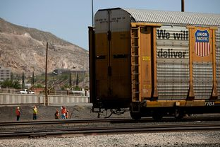 Men work on the railroad tracks at the Union Pacific railyard in El Paso on Tuesday, May 6, 2014.