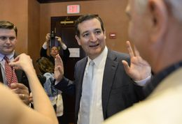 U.S. Sen. Ted Cruz banters with reporters after a short press avail at the Stephen F. Austin hotel on May 16, 2014.