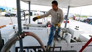 Ismael Gonzalez, 22, with DNT Construction filled his tanker truck with dyed diesel fuel at Tex-Con Oil Company on May 20, 2014, in Austin.
