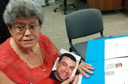 Bonnie D'Amico holds a photograph of her son Nicholas D'Amico, who committed suicide after being honorably discharged from the U.S. Army.
